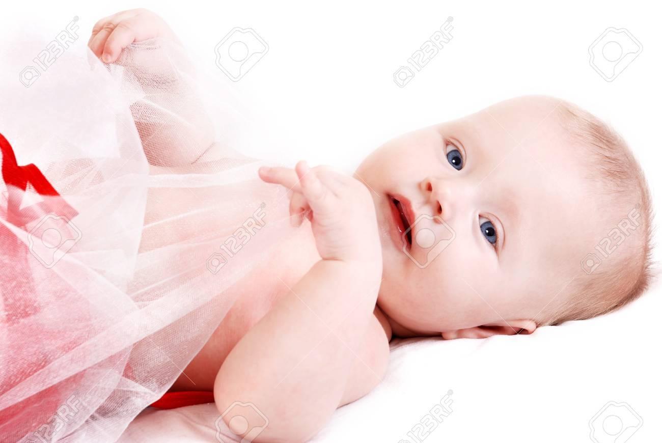 Beautiful blue eyed infant girl lying over white Stock Photo - 13171013