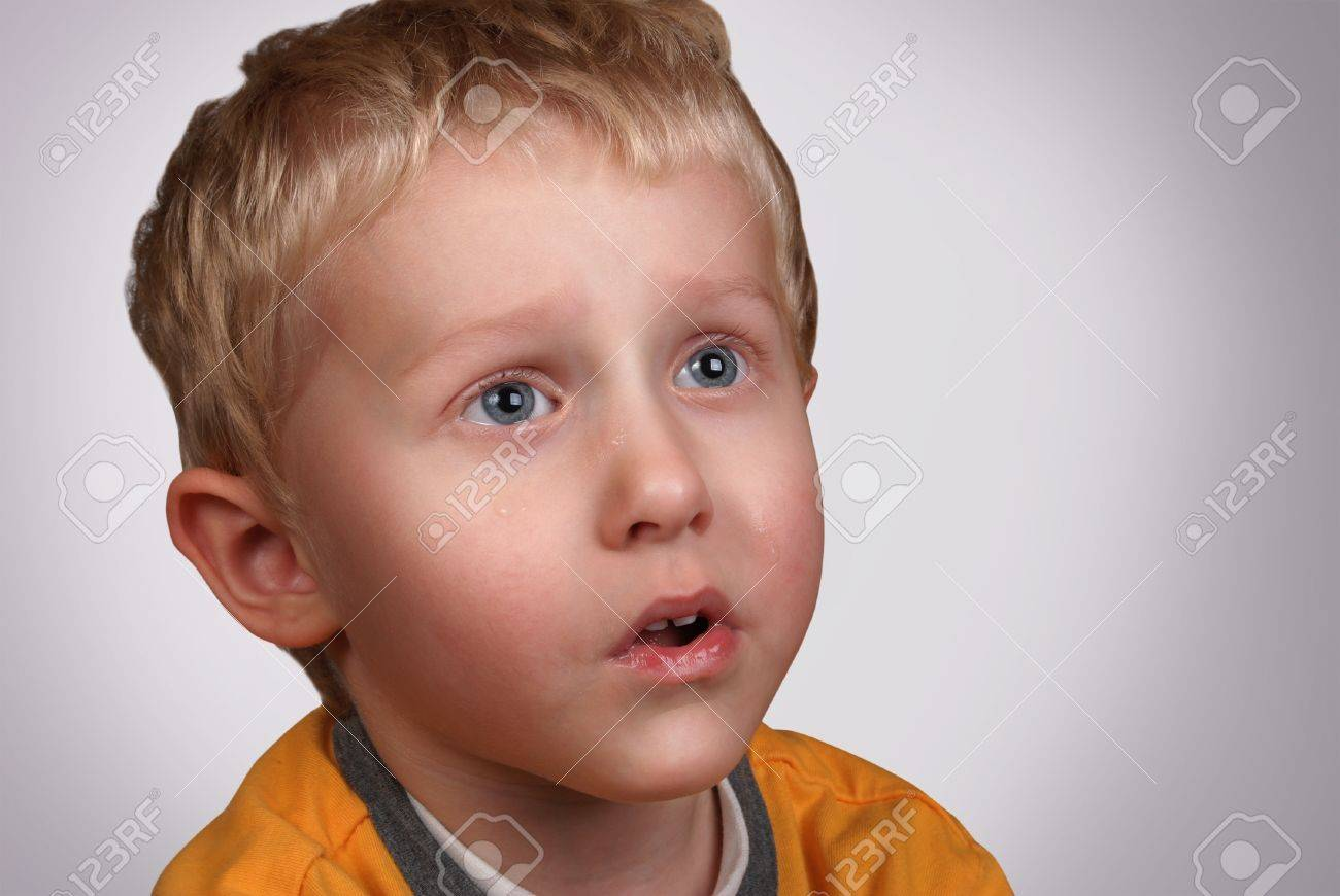Crying boy portrait on light gray background Stock Photo - 14767548