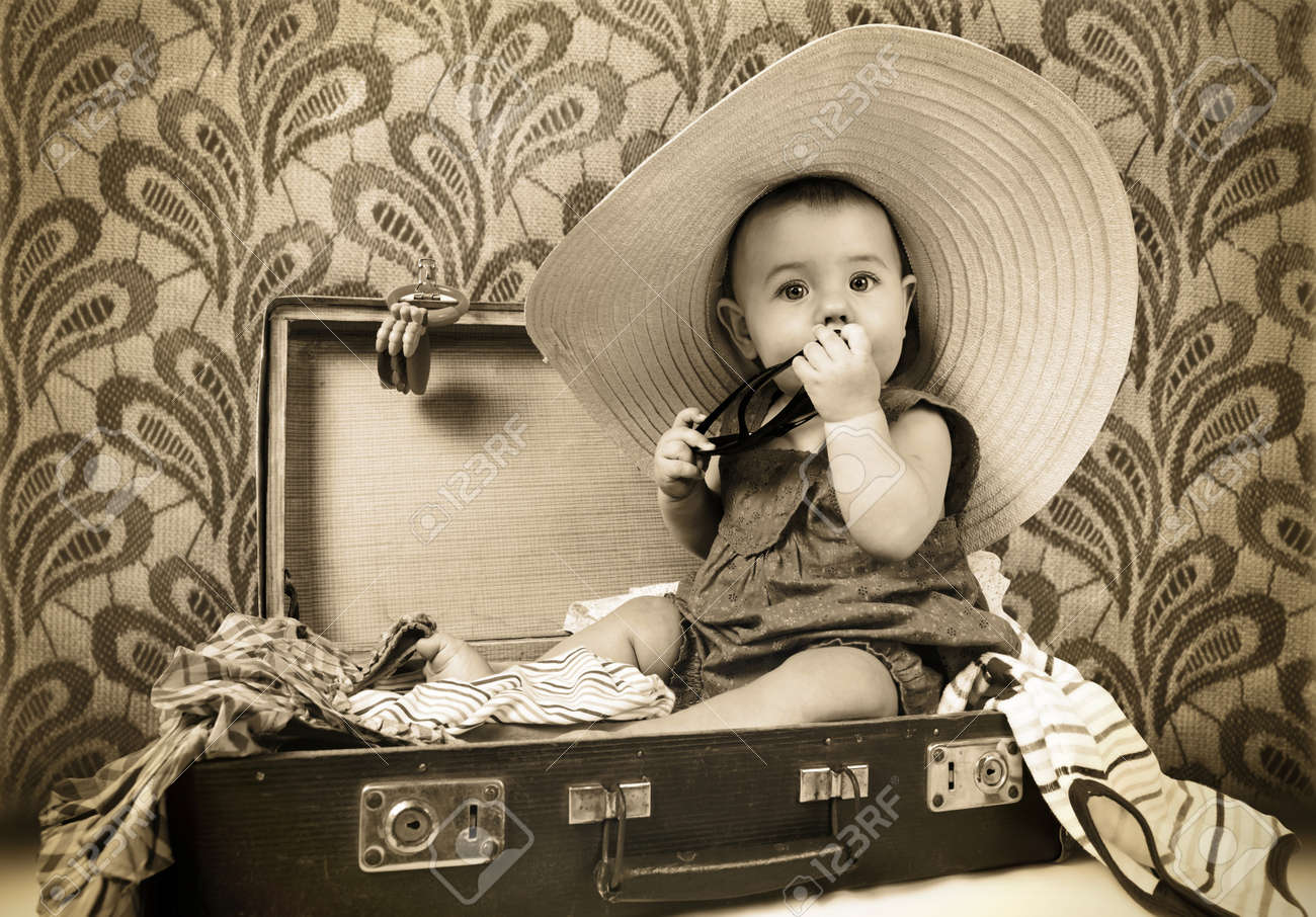 http://previews.123rf.com/images/soloway/soloway1212/soloway121200015/16792467-Baby-girl-sitting-into-the-old-suitcase-retro-image-Stock-Photo.jpg