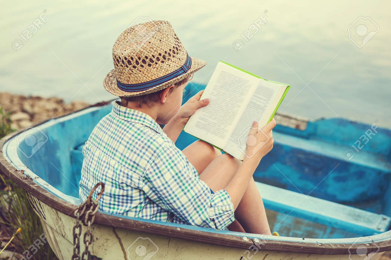 Worksheet Reading Boat reading boy in old boat stock photo picture and royalty free 41909015