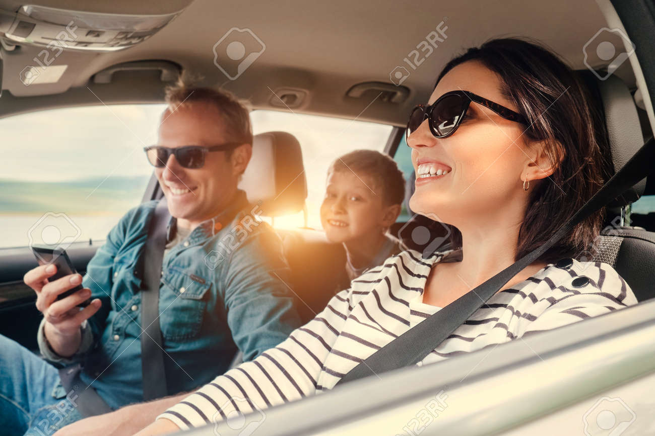 Happy family riding in a car - 59458714
