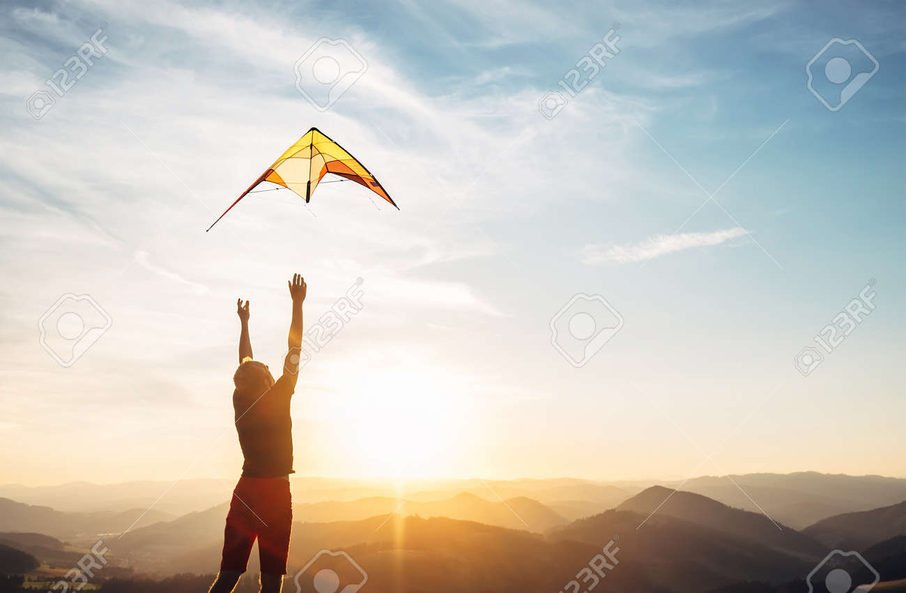 Man start to fly a kite in the sky - 107564882