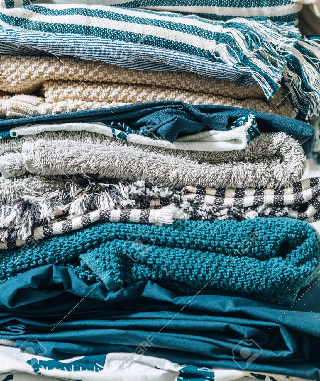 Close-up image of folded home textile. Home work concept image. - 114529748