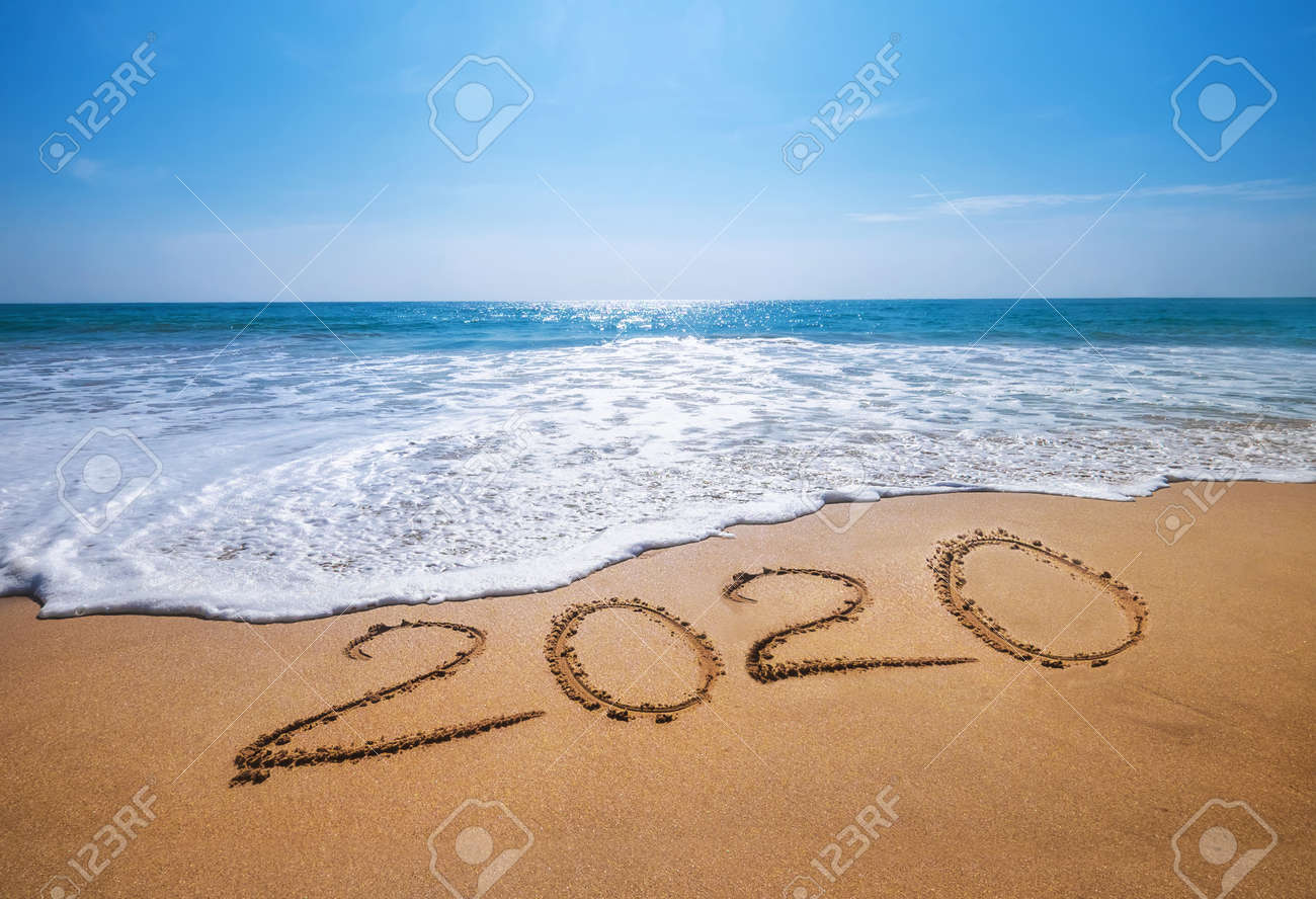 Happy New Year 2020 is coming concept sandy tropical ocean beach lettering. - 130603220