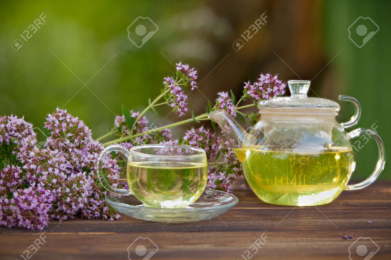 delicious green tea in a beautiful glass bowl on a table - 99941165