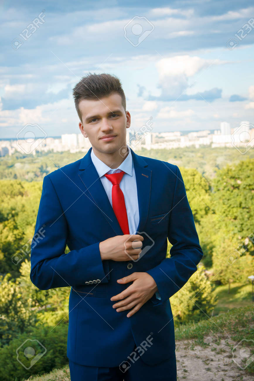Young Handsome Business Man In Blue Suit With White Shirt And