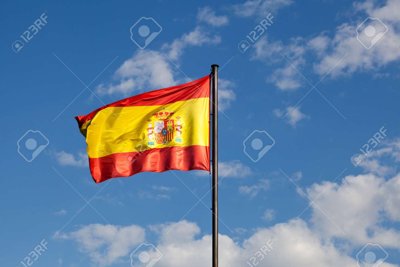 Spanish Flag in a Blue Sky Stock Photo - 13884425