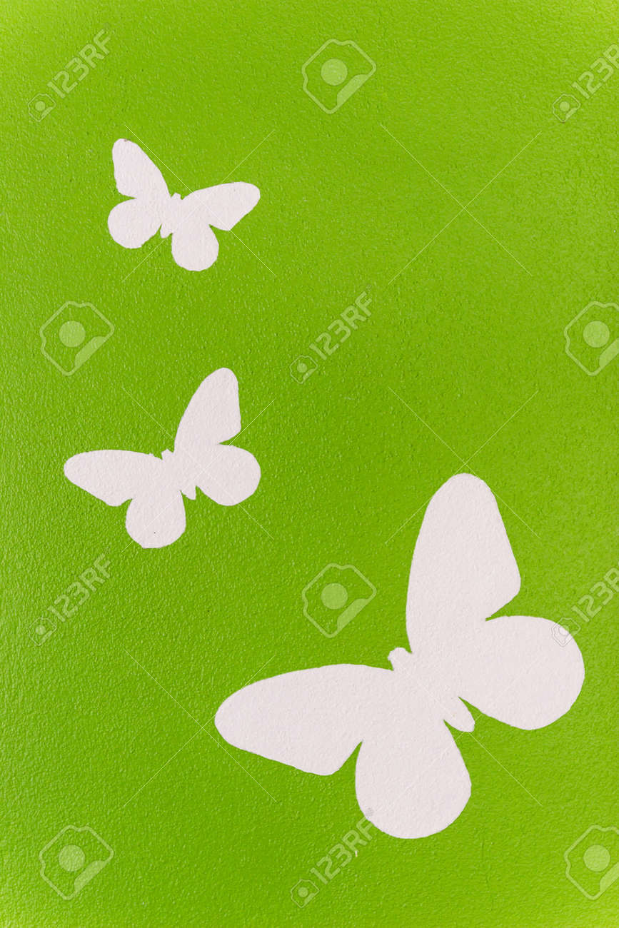 White Butterfly Painting On Green Wall Stock Photo Picture And