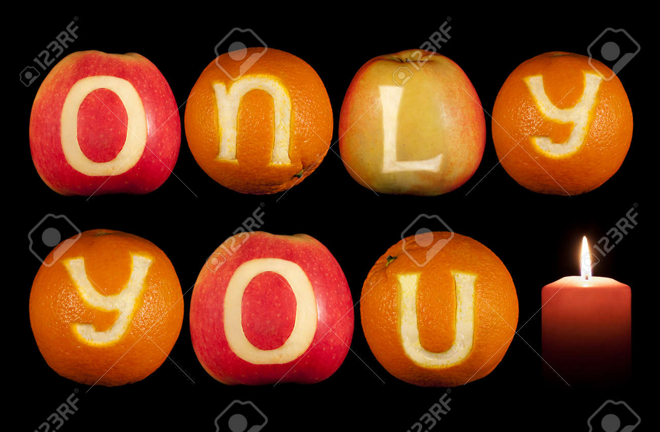 c4f22f4dba Stock Photo - Words ONLY YOU carved on oranges and apples isolated on black
