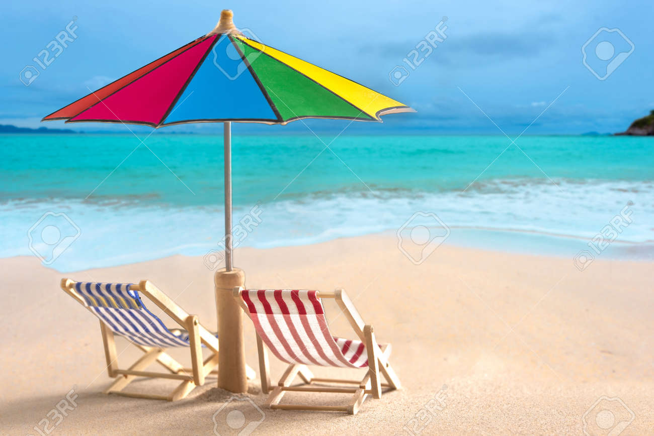 Beach chairs and with umbrella and beautiful beach on a sunny..
