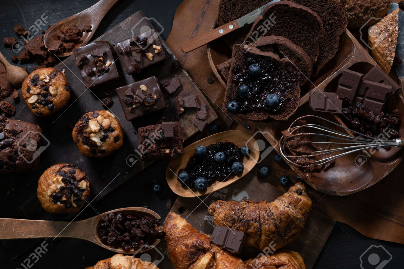 Pastry and bakery, desserts, cakes and cookies close-up on the dark background. - 135034037