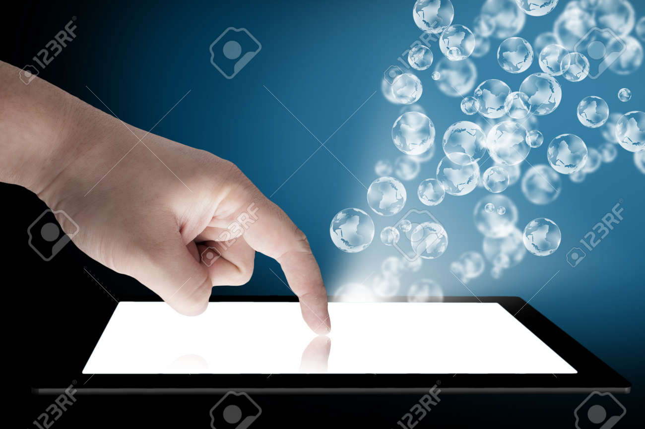 Businessman touch tablet PC screen with globe coming out from the screen  Concept for internet, email, and connectivity Stock Photo - 13066012