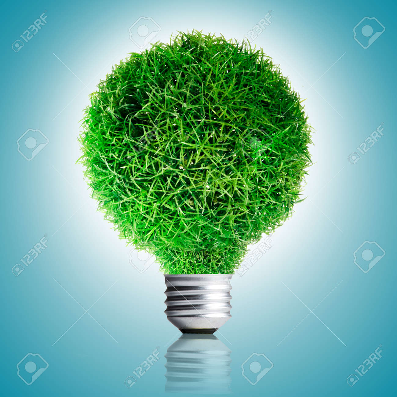 Green Grass growing on Light bulb on blue background  Concept for eco-friendly Stock Photo - 13733033