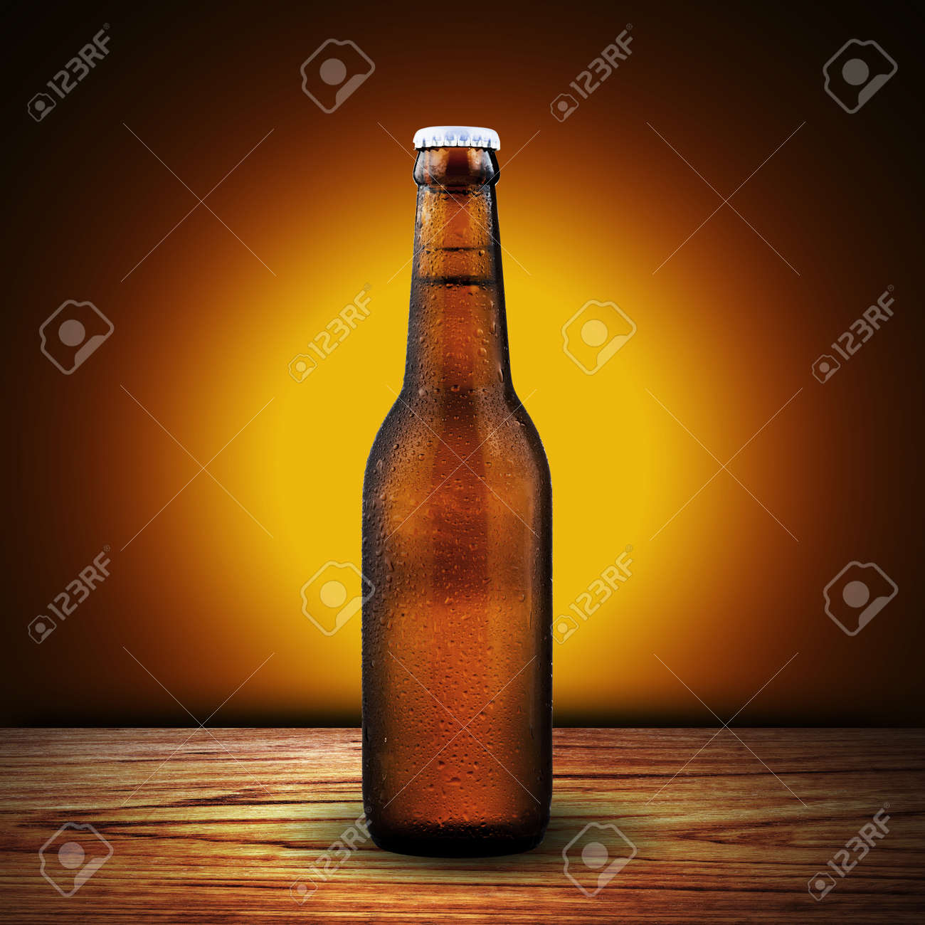 Bottle of beer on wood table with yellow background Stock Photo - 18249837