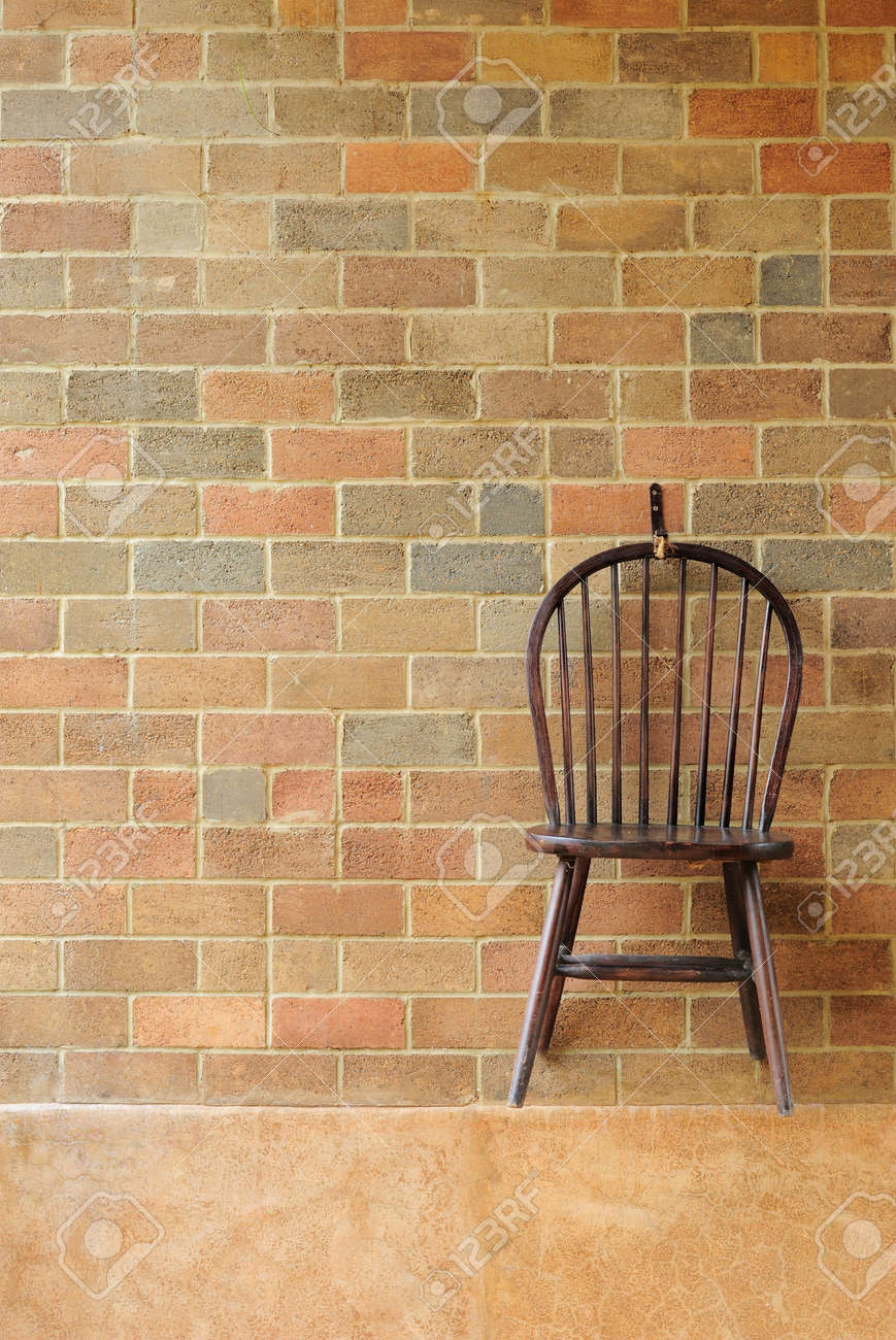 Red brick wall and chair on the wall Stock Photo - 14853112