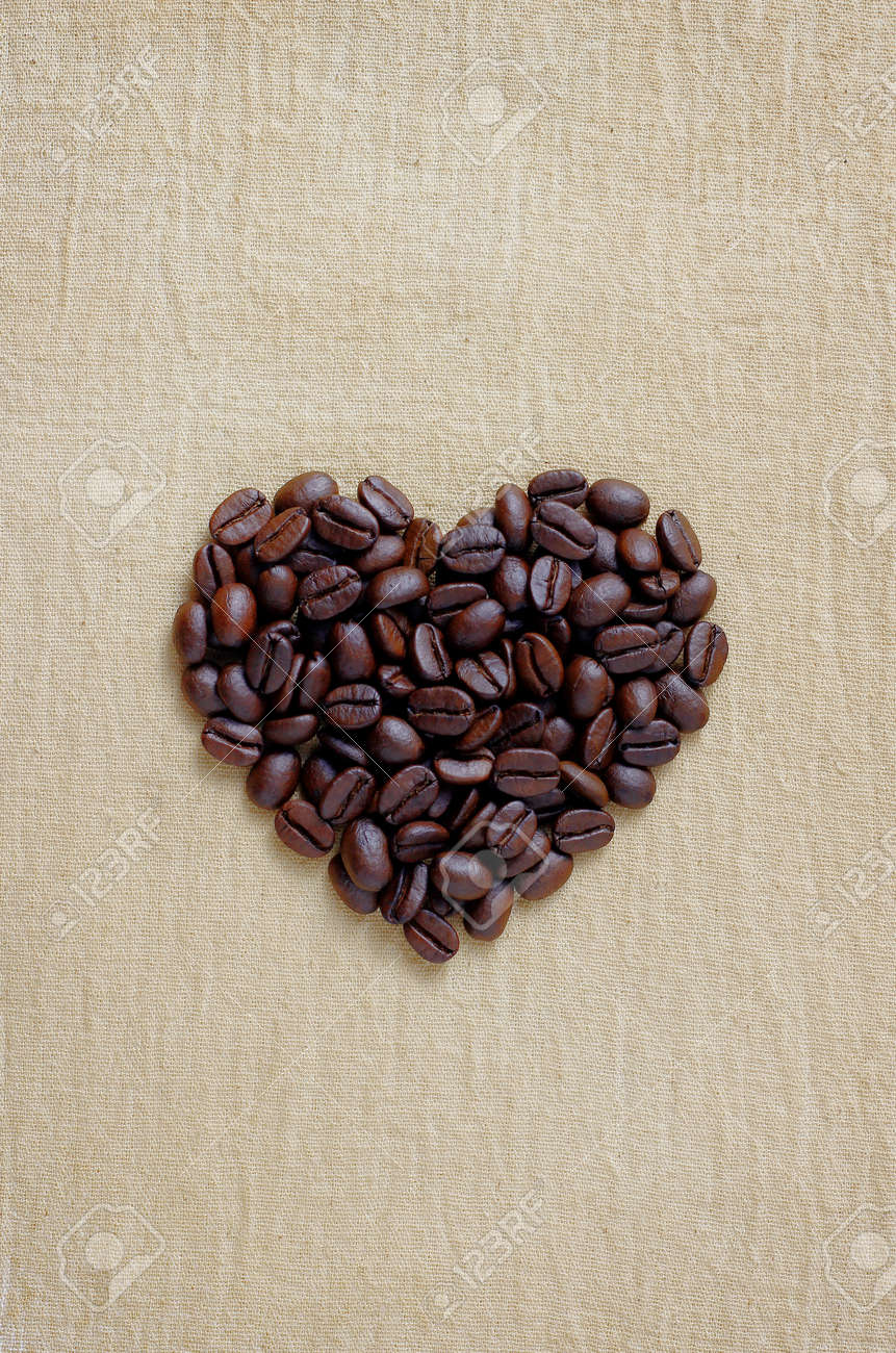Coffee lover sign pile of brown coffee beans in heart shape coffee lover sign pile of brown coffee beans in heart shape close up of biocorpaavc Image collections