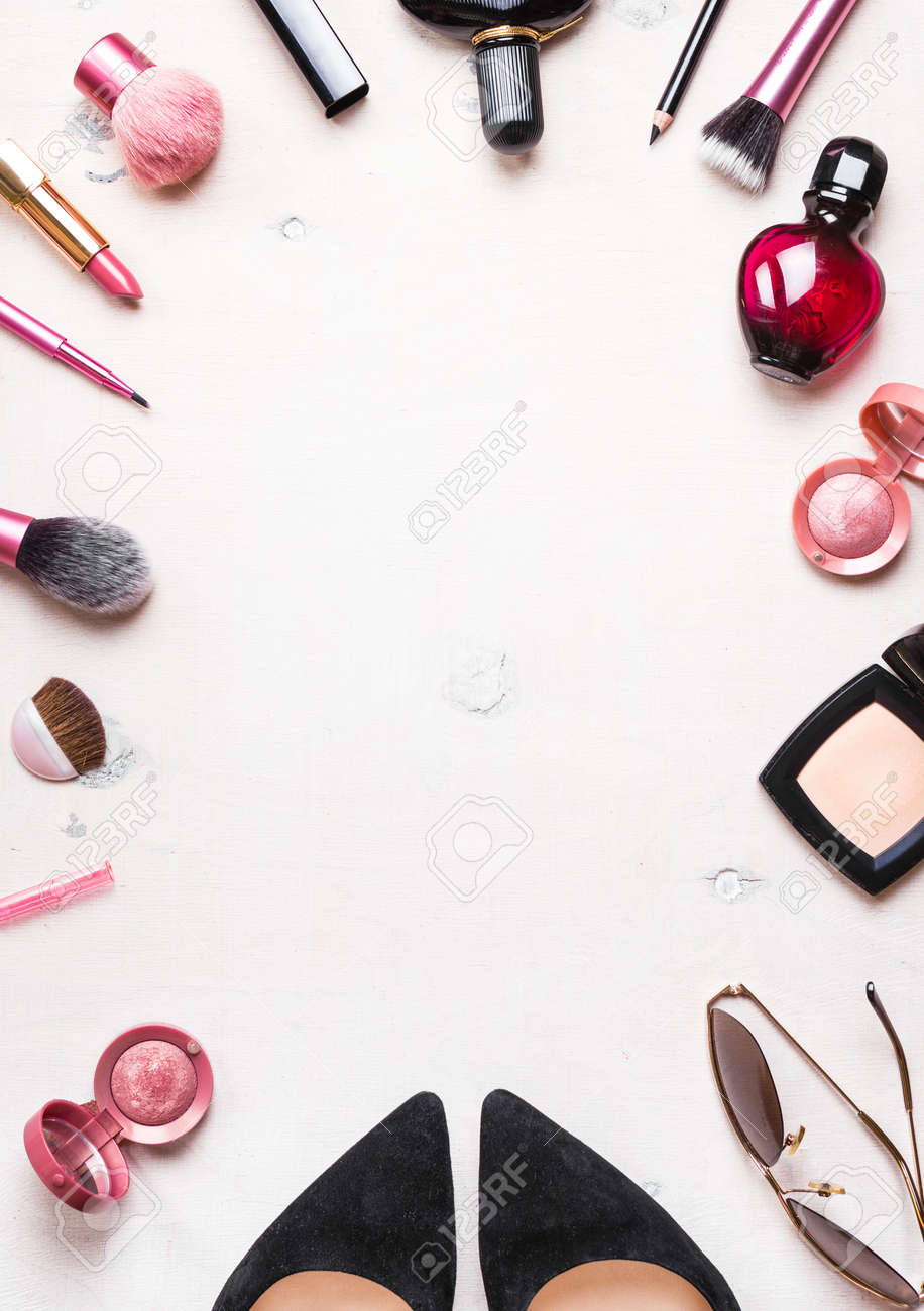 Feminine cosmetic background. Overhead of essentials of a modern woman. Cosmetic objects frame - 46103184