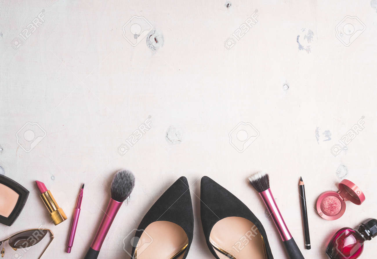 Feminine cosmetic background. Overhead of essentials of a modern woman. Cosmetic objects frame. - 46103205
