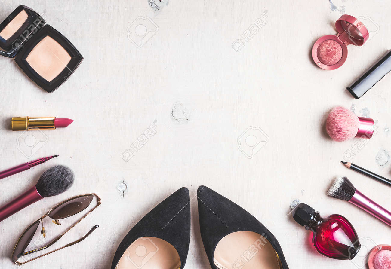 Feminine cosmetic background. Overhead of essentials of a modern woman. Cosmetic objects frame. - 46103206
