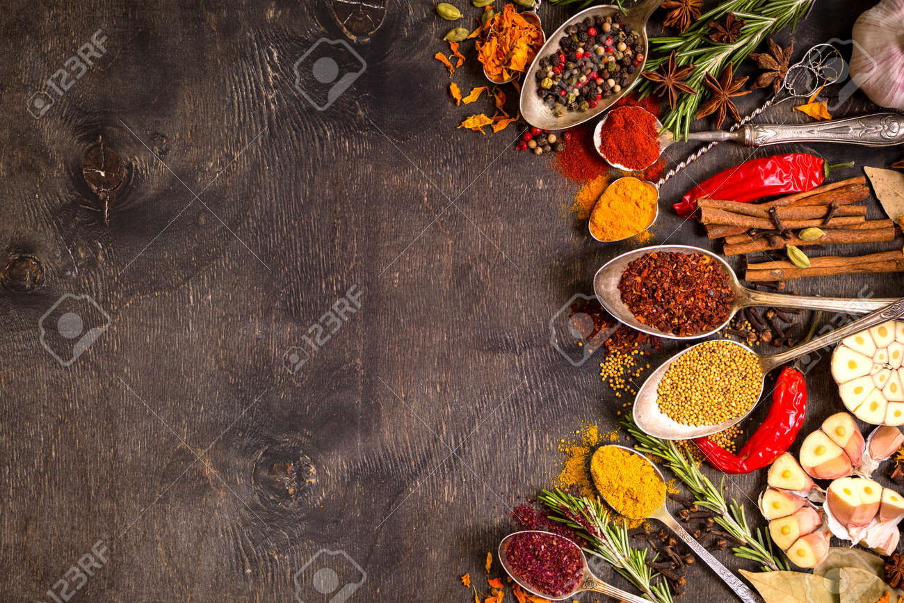 Set of various aromatic colorful spices in old vintage spoons and herbs on a dark wooden background. Space for text. Food frame. Ingredients for cooking. Top view - 55247676