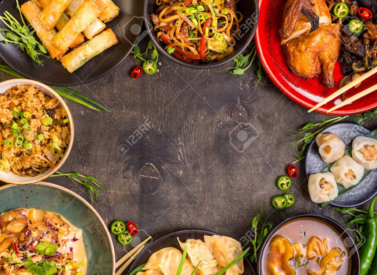 Chinese food dark background. Chinese noodles, fried rice, dumplings, peking duck, dim sum, spring rolls. Famous Chinese cuisine dishes set. Space for text. Top view. Chinese restaurant concept - 62444406
