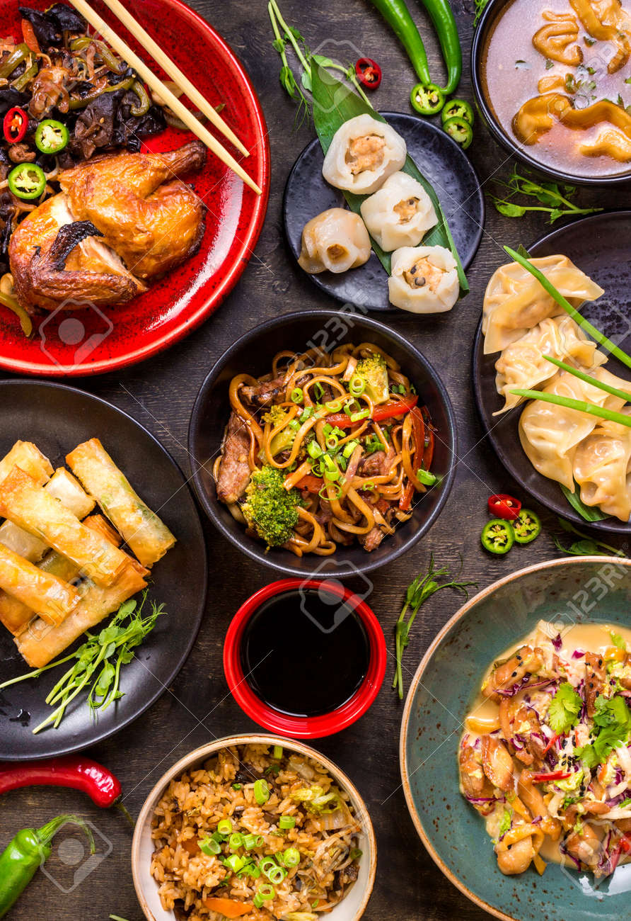 Assorted Chinese food set. Chinese noodles, fried rice, dumplings, peking duck, dim sum, spring rolls. Famous Chinese cuisine dishes on table. Top view. Chinese restaurant concept. Asian style banquet - 62444425