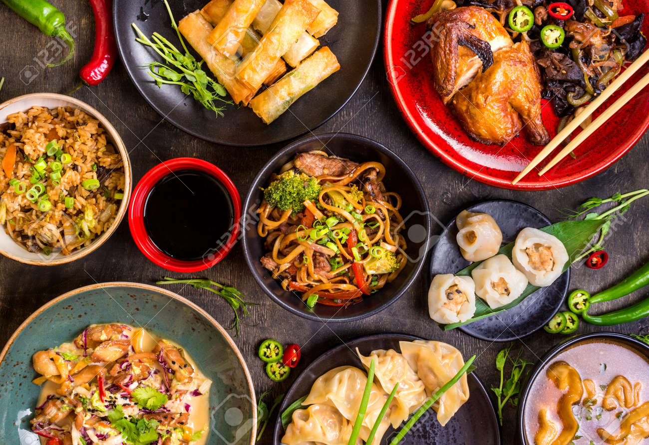Assorted Chinese food set. Chinese noodles, fried rice, dumplings, peking duck, dim sum, spring rolls. Famous Chinese cuisine dishes on table. Top view. Chinese restaurant concept. Asian style banquet - 62444725
