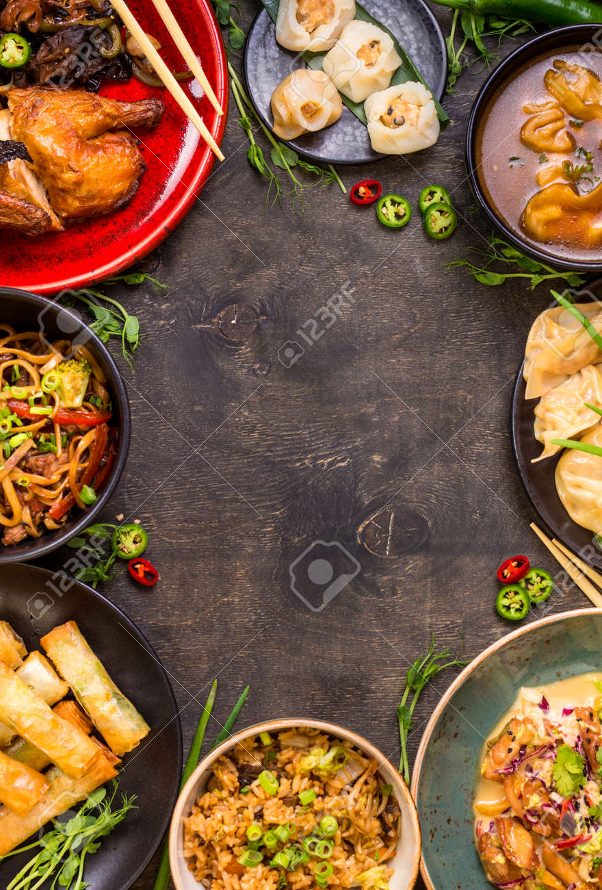 Chinese food dark background. Chinese noodles, fried rice, dumplings, peking duck, dim sum, spring rolls. Famous Chinese cuisine dishes set. Space for text. Top view. Chinese restaurant concept - 62444736
