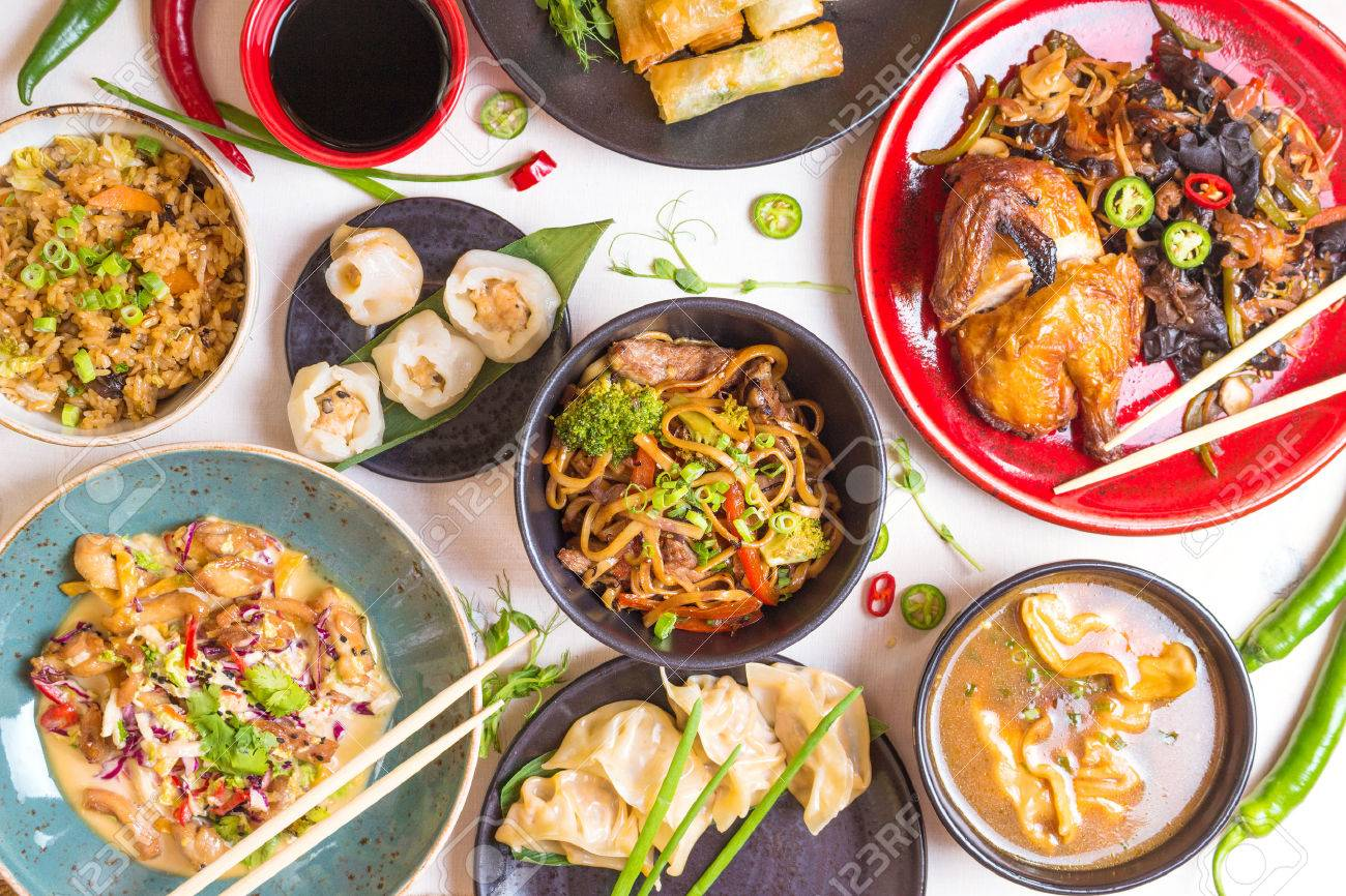 Assorted Chinese food set. Chinese noodles, fried rice, dumplings, peking duck, dim sum, spring rolls. Famous Chinese cuisine dishes on white table. Top view. Chinese restaurant concept. Asian style - 62444801