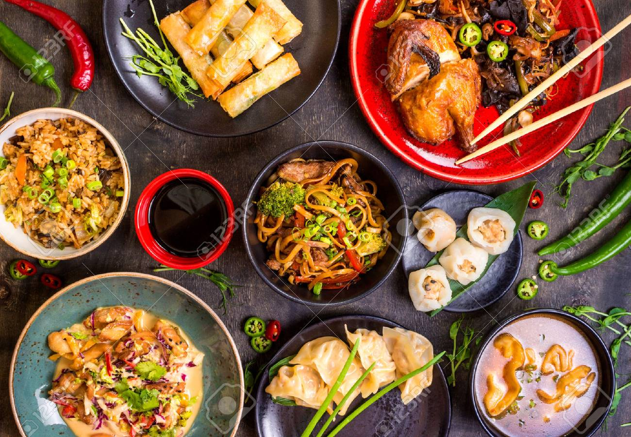 Assorted Chinese food set. Chinese noodles, fried rice, dumplings, peking duck, dim sum, spring rolls. Famous Chinese cuisine dishes on table. Top view. Chinese restaurant concept. Asian style banquet - 62444805
