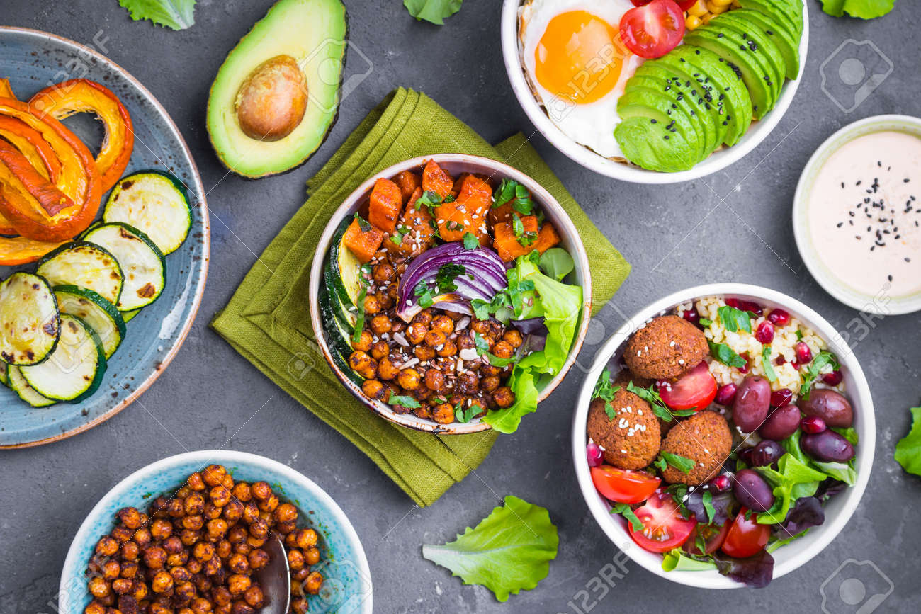 Mixed healthy vegetarian salads with vegetables, sweet potato, falafel, bulgur, avocado, eggs. Assorted buddha bowl salads. Vegetarian food. Healthy lunch/dinner. Salad in bowl. Ingredients for making - 80508053