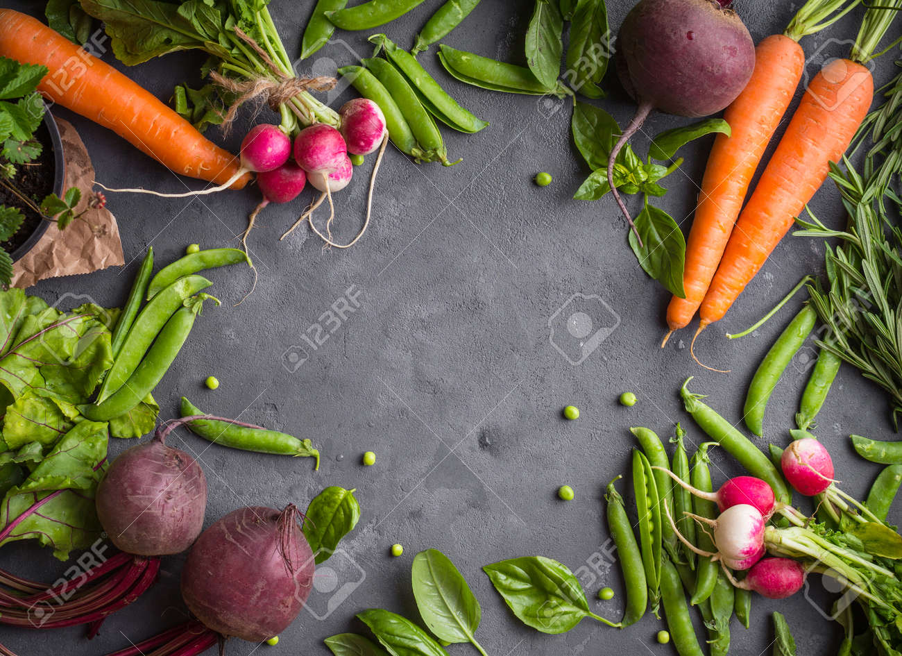 Fresh vegetables on rustic concrete background. Carrot, beet, radish, green pea, herbs. Harvest/gardening concept. Healthy food. Vegetarianism. Clean eating. Space for text. Making salad ingredients - 84059739