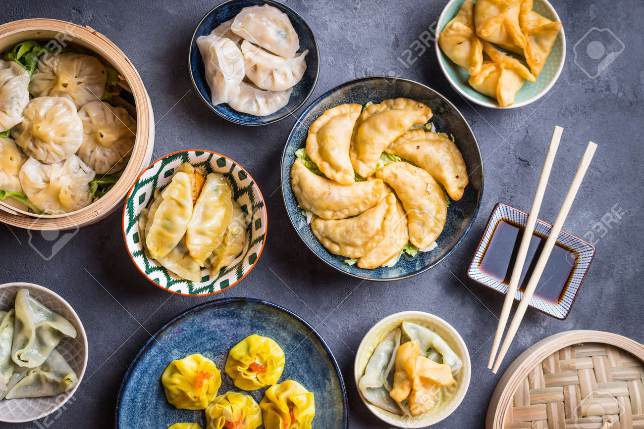 Assorted Dim Sum Appetizers On Rustic Background Set Of Chinese Food For Share Asian