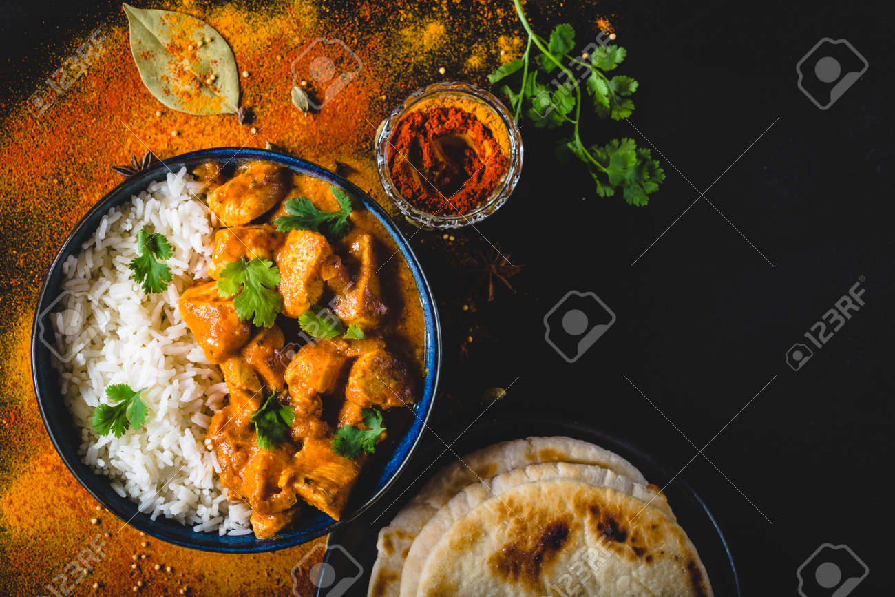 Indian Butter Chicken With Basmati Rice In Bowl Spices Naan Stock Photo Picture And Royalty Free Image Image 94113232