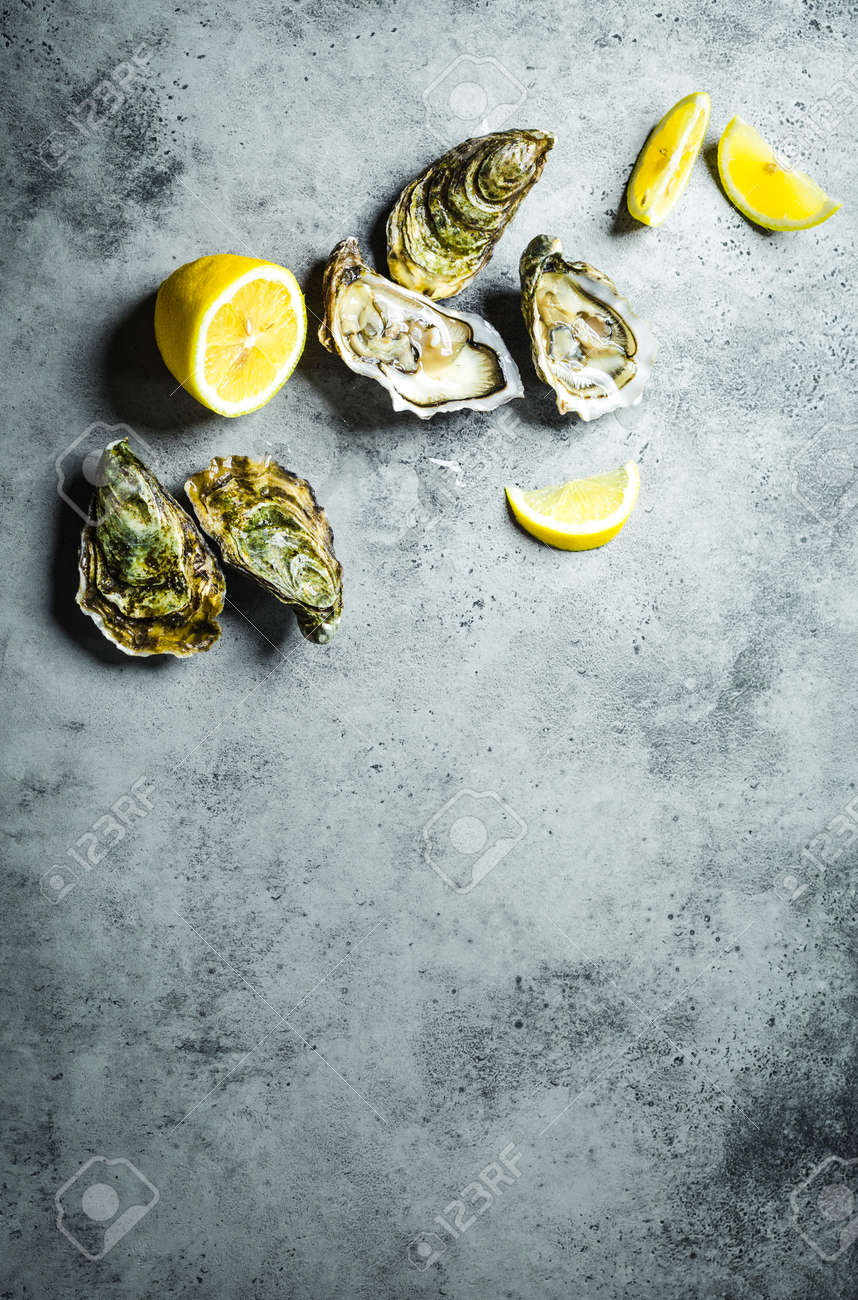 Rustic Stone Background Opened Fresh Raw Oysters Top