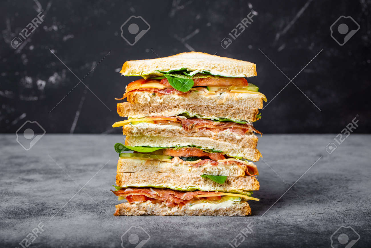 Close up of tall cut tasty sandwich - 117898562