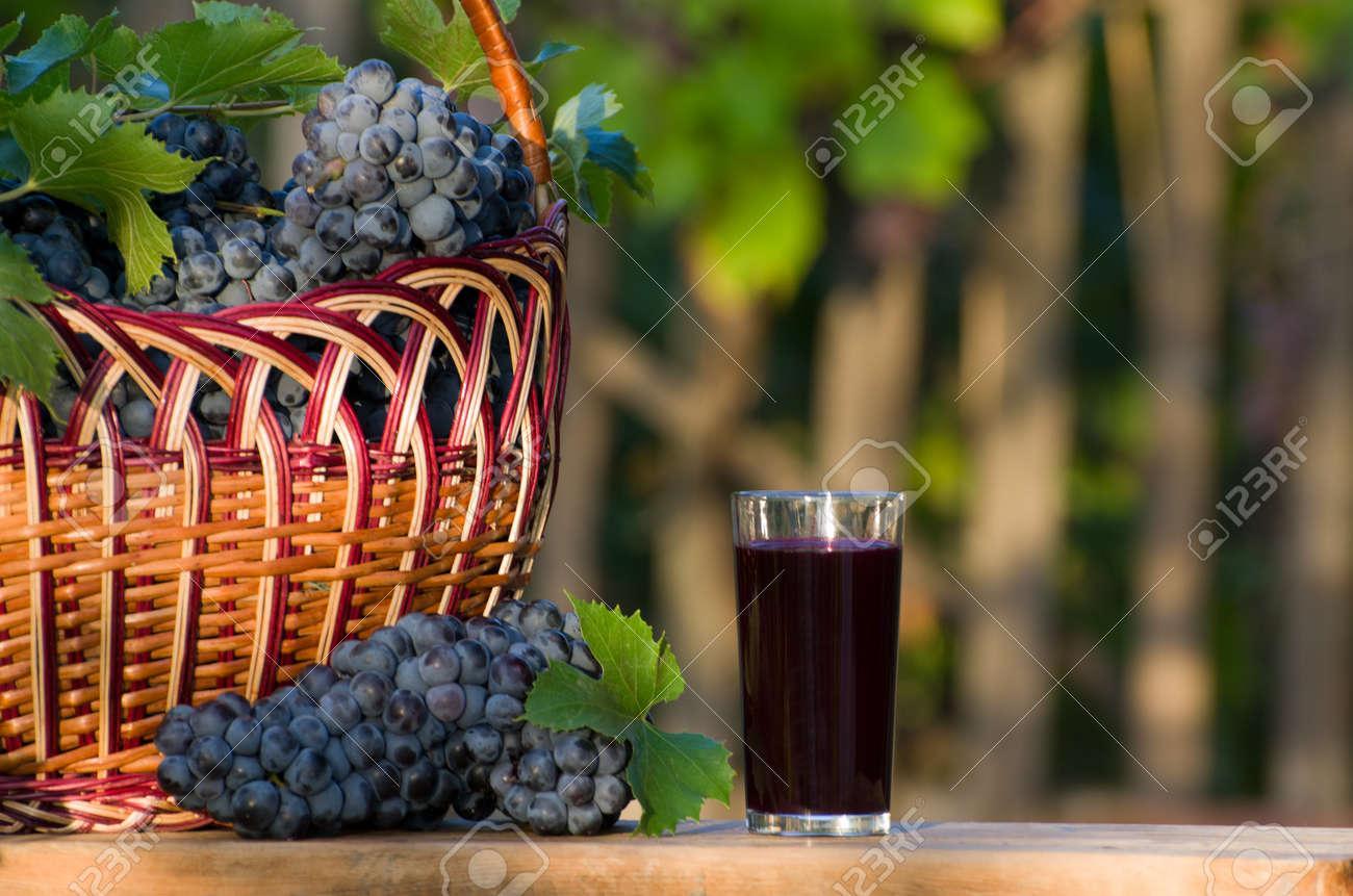 Glass Of Grape Juice With Grapes Wicker Basket, A Garden In The ...