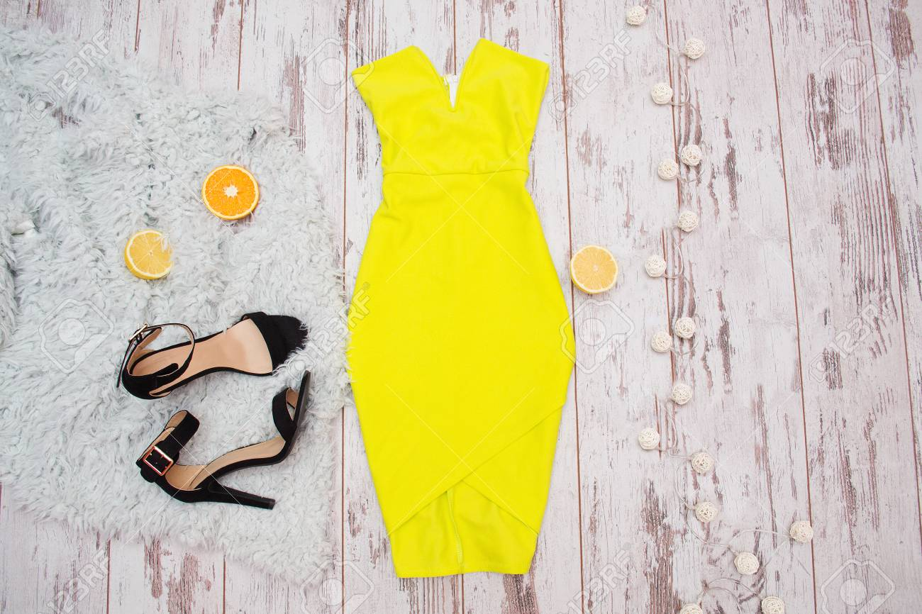 Bright Yellow Dress, Black Shoes, And