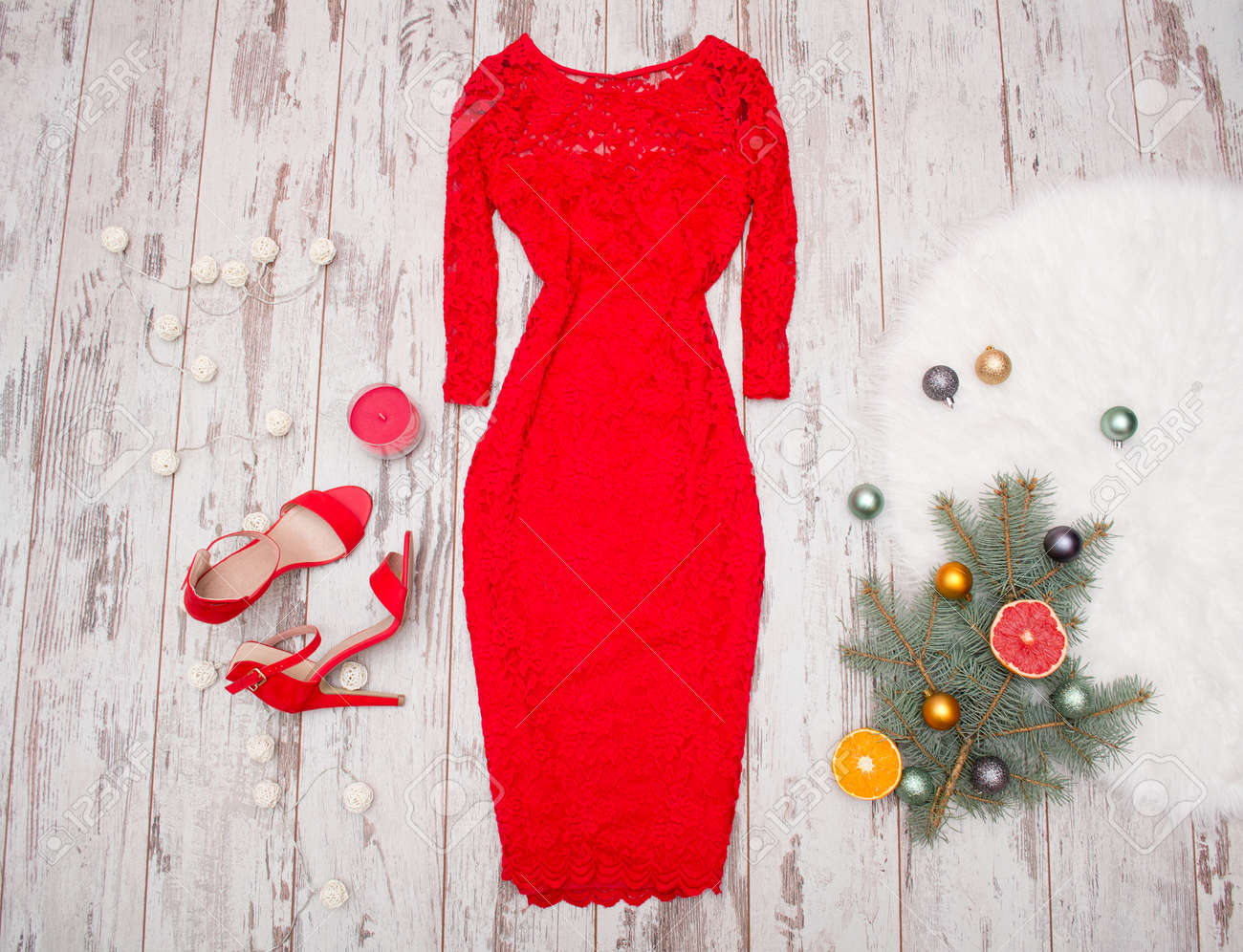 Red Elegant Lace Dress Red Shoes On A Wooden Background Fir