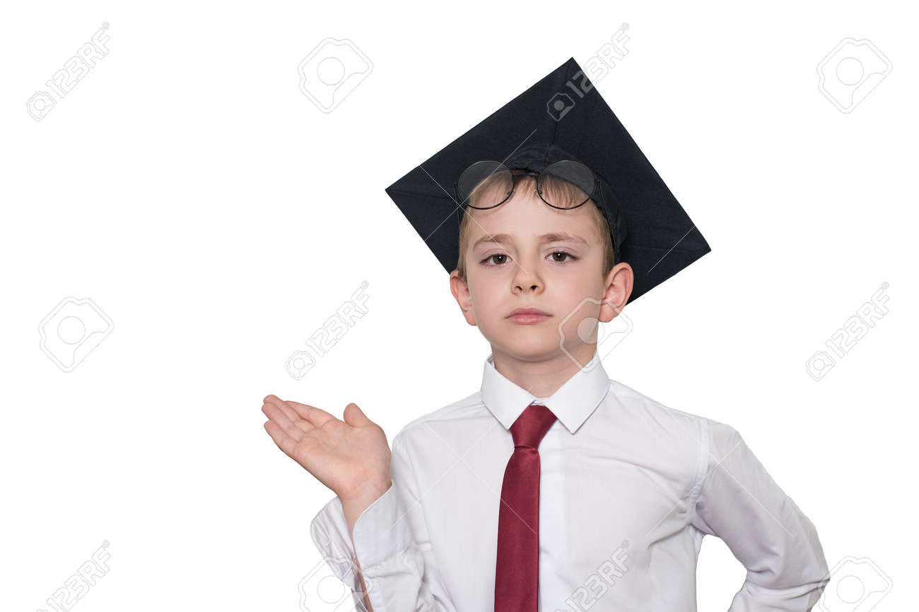 Boy in a square academic hat and glasses holds his palm up. School concept. Isolate - 126244502