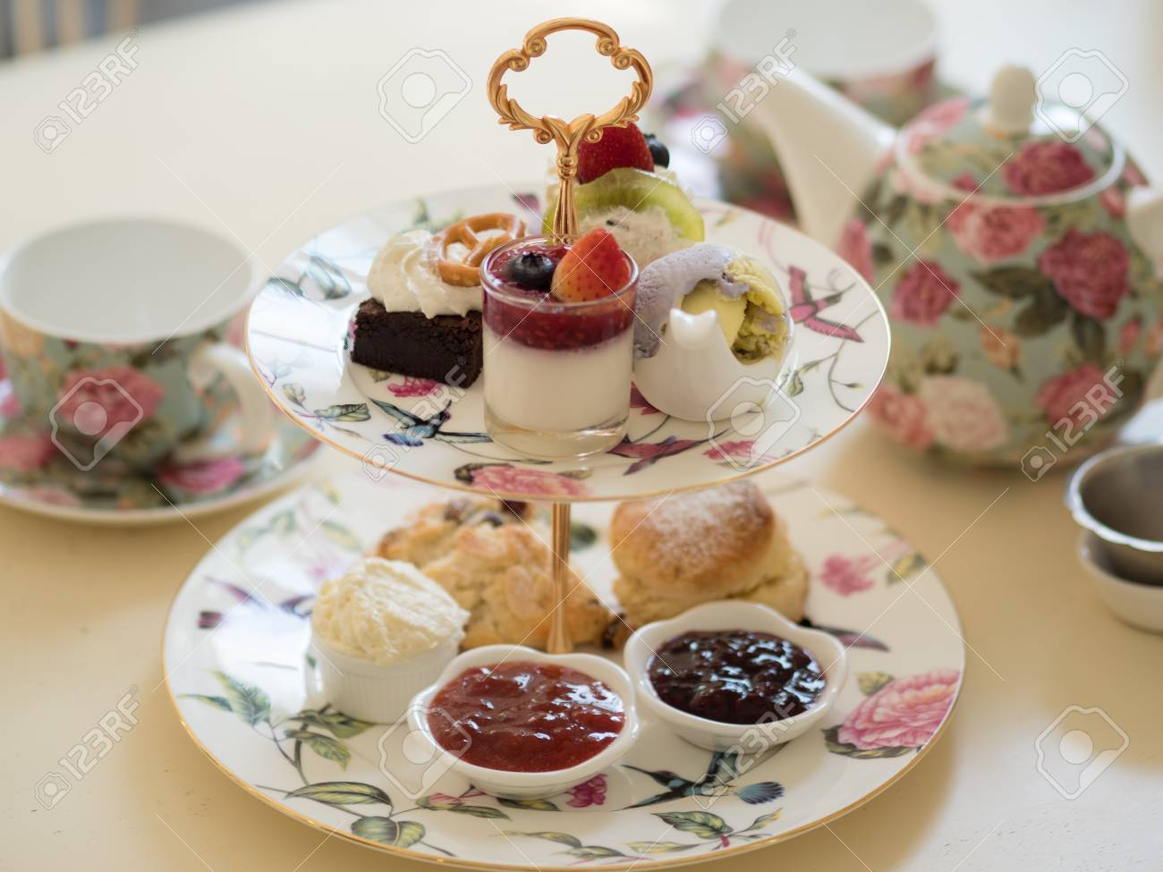 british afternoon tea scones with home made jam and icecream - 93763309