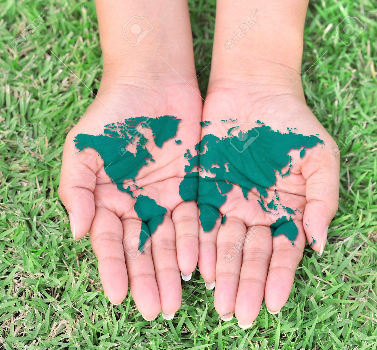 World Map On Hands.The Open Hands Of World Map Stock Photo Picture And Royalty Free