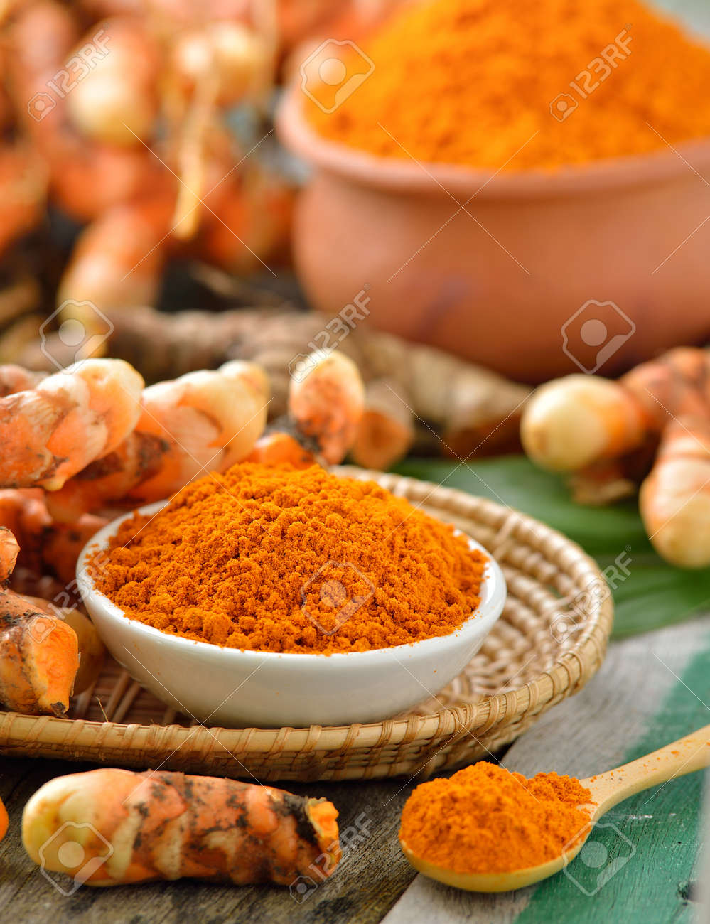 turmeric roots in the basket on wooden table - 47729406
