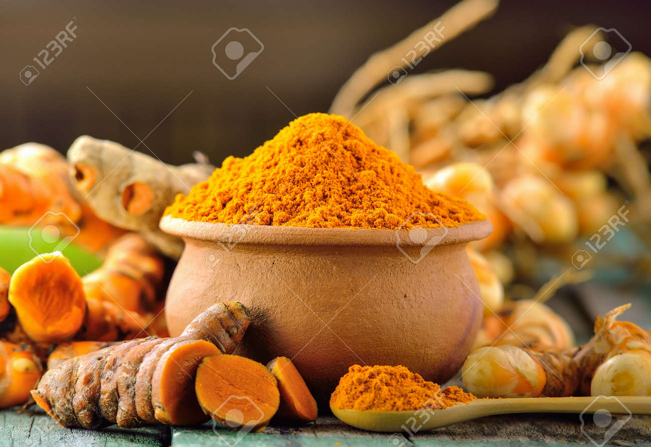 turmeric roots on wooden table - 47729254