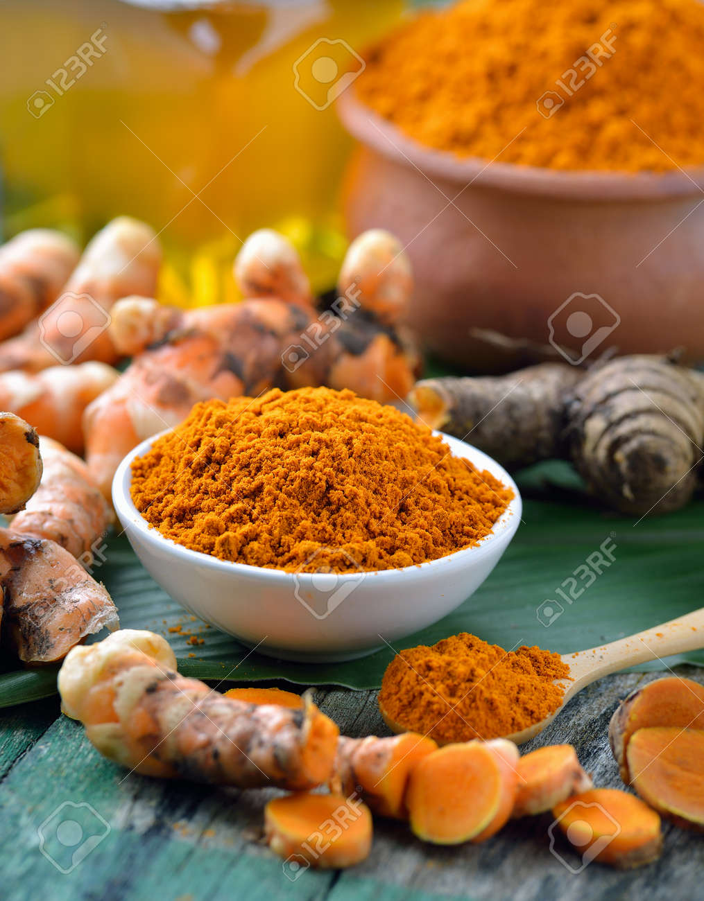 fresh turmeric roots on wooden table - 47729204