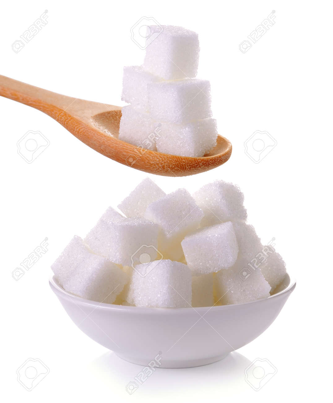 sugar cube in the spoon and bowl on white background - 48862726