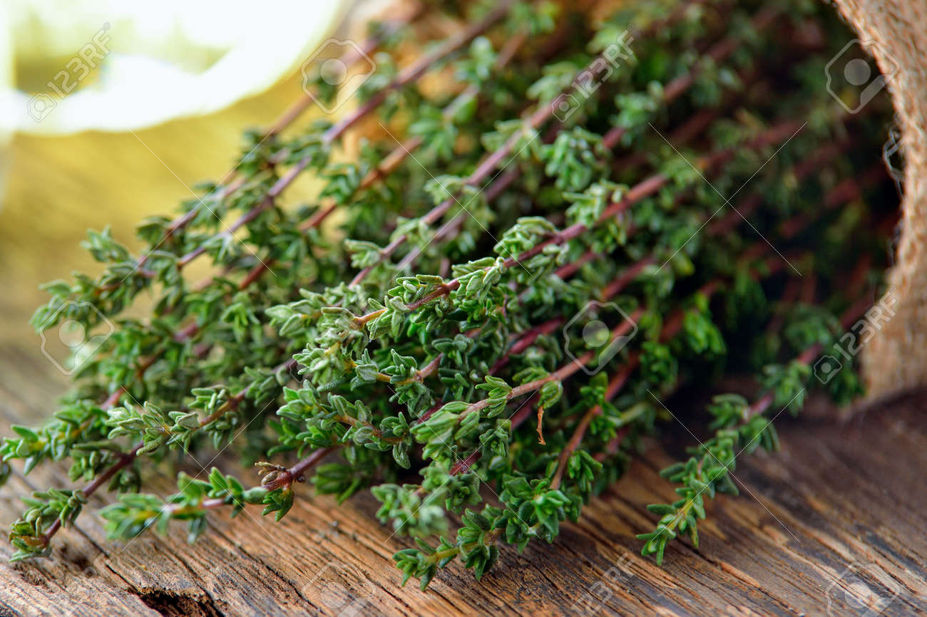 Thyme herb in basket on wooden table. - 80037779