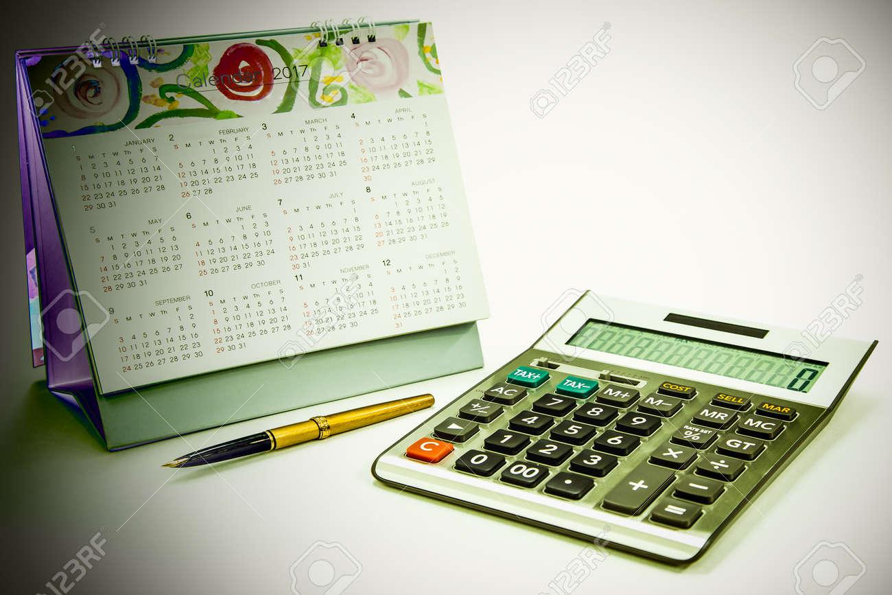 Calculator Fountain Pen And Calendar On White Background Stock Photo