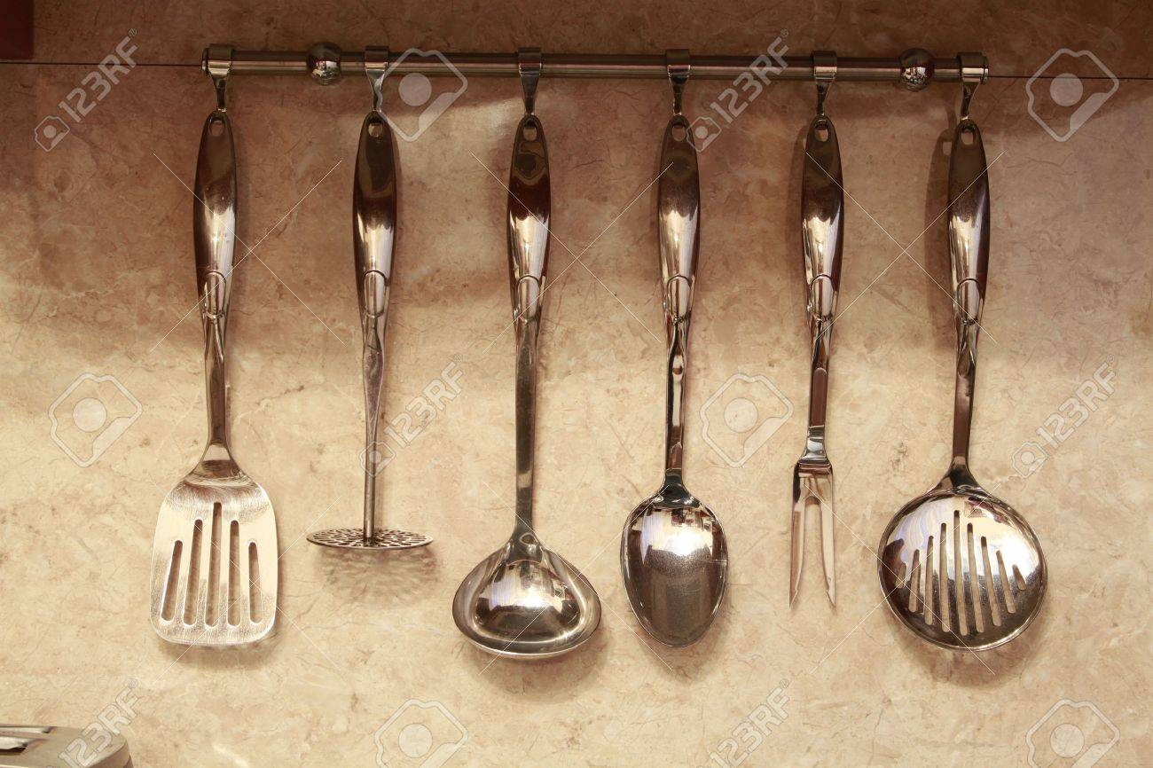 Set Of Kitchen Utensils Hanging On The Wall Stock Photo   14571481