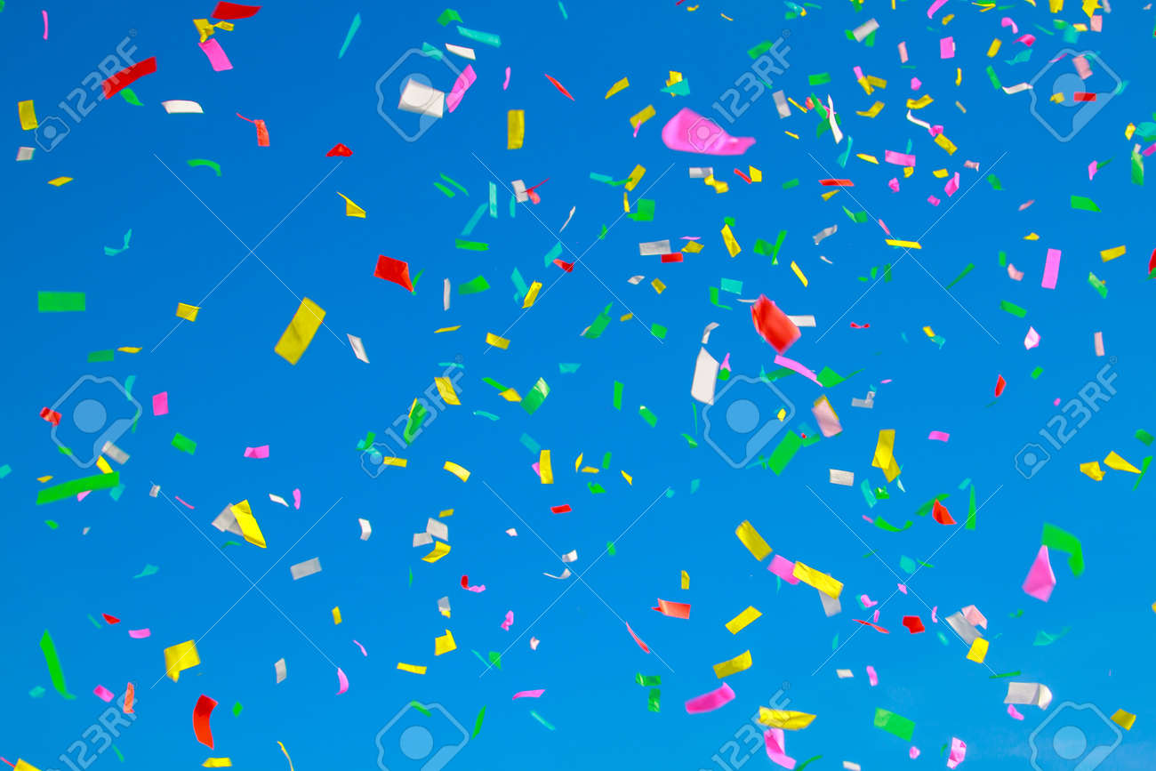 multicolored confetti on clear blue sky background - 148557794
